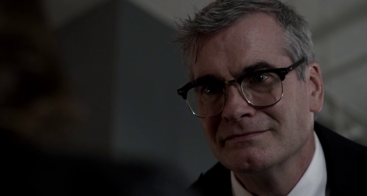 Henry Rollins staring off-centre of the camera, giving one of the best character portrayals in the movie.
