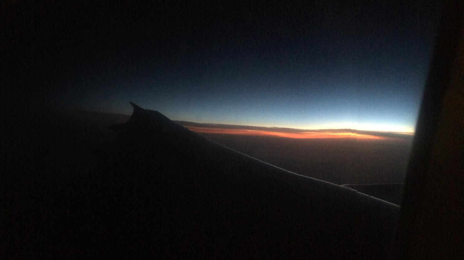 A sunset aboard a plane back from Portugal - my first time truly relaxing in years.