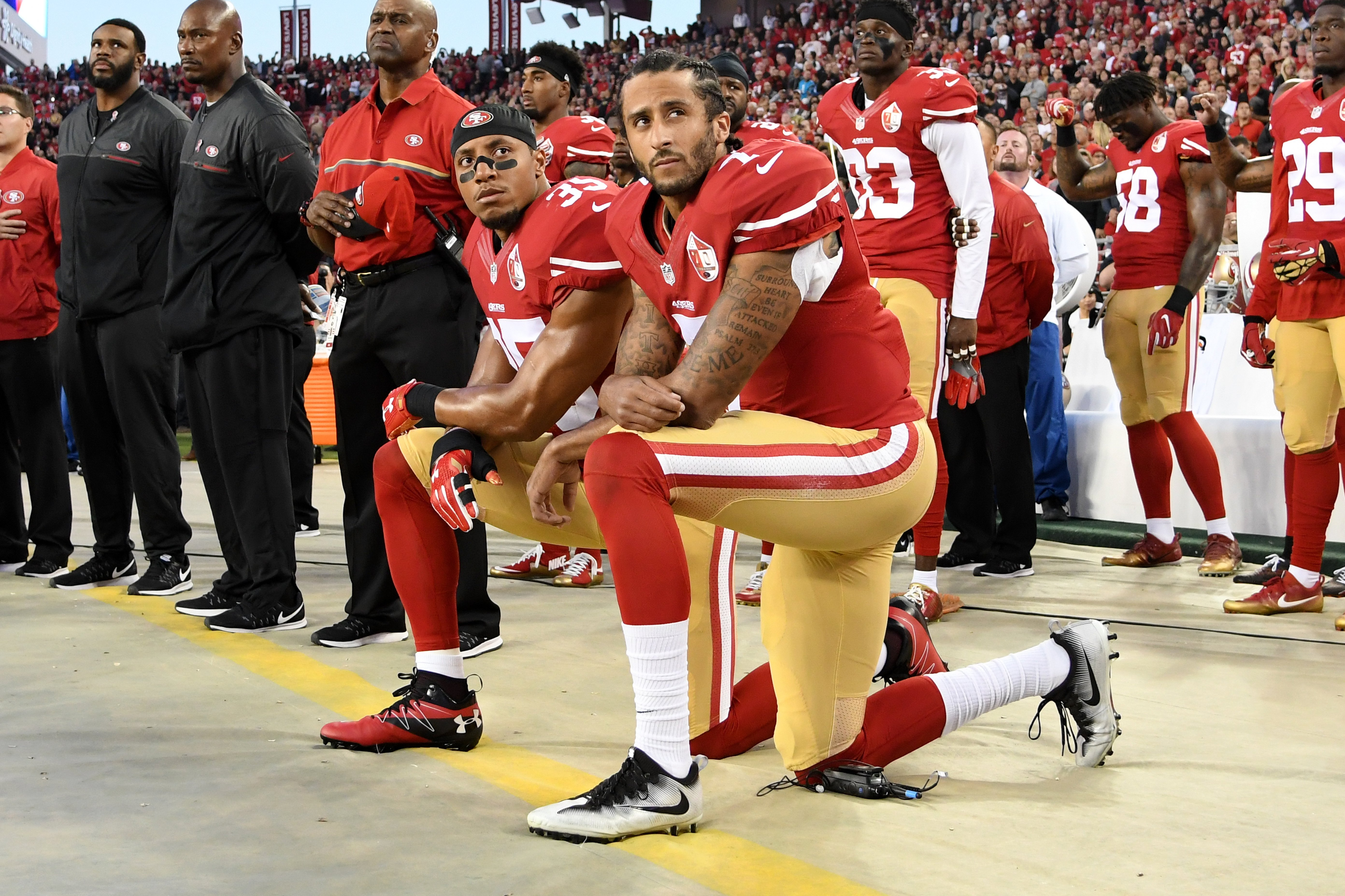 To knee or not to knee: Quarterback's protest sparks debate over racism and patriotism
